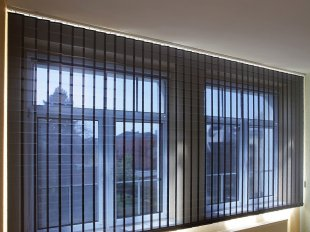 Vertical louver blind with pleated film slats