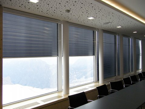 Large electrical XXL roller blinds as sun protection for conference rooms