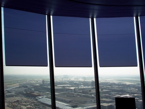 Glare protection with transparent film roller blinds at airport tower London Heathrow